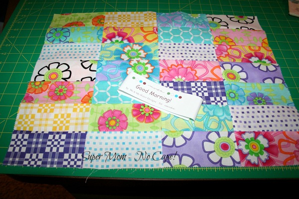 Doll Quilt top made with leftover charm squares