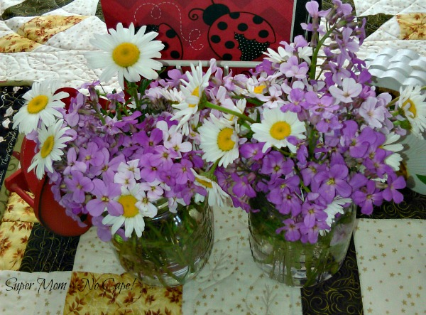 Wild flowers arranged in mason jar vases