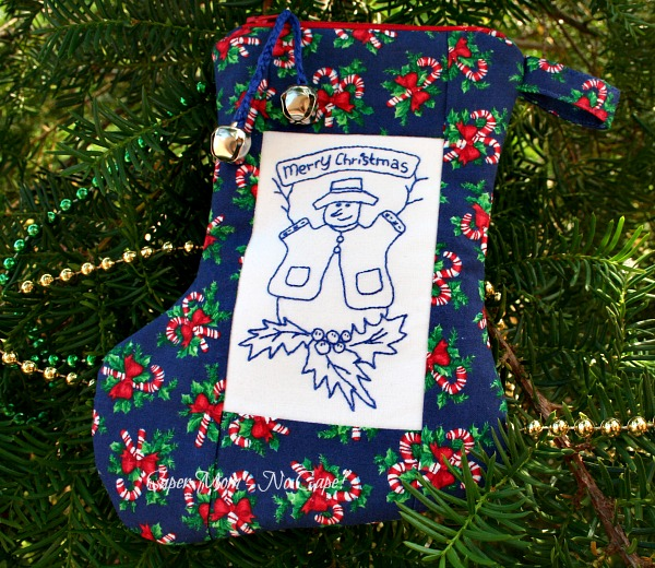 Zippered Pouch Christmas Stocking with Bluework snowman embroidery in the center
