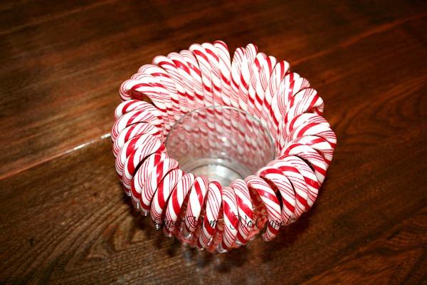 Candy canes arranged around the vase