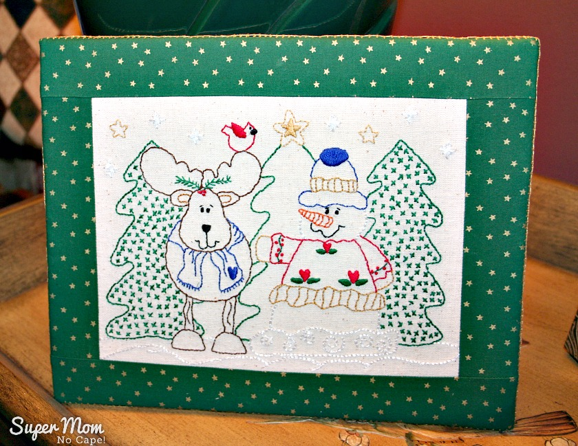 Reidneer and Snowman embroidery mounted on flat board