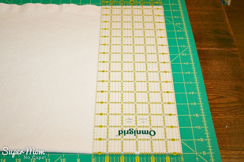Squaring up one edge of the canvas in preparation of making the Painted Maple Leaf Table Runner