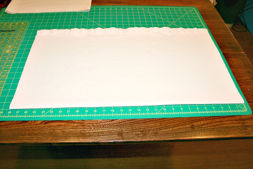 Showing the canvas for the Painted Maple Leaf Table Runner cut to the desired size