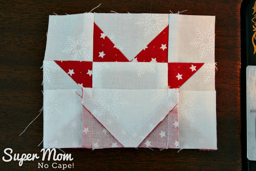 Sawtooth Star with Applique Center Ornament 21. Flip bottom row up onto center row