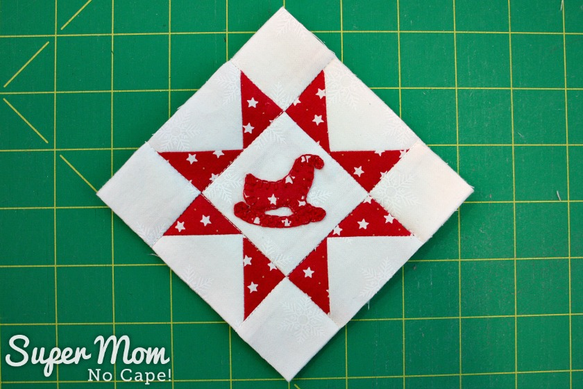 Sawtooth Star with Applique Center Ornament 31. Trim and Square up block