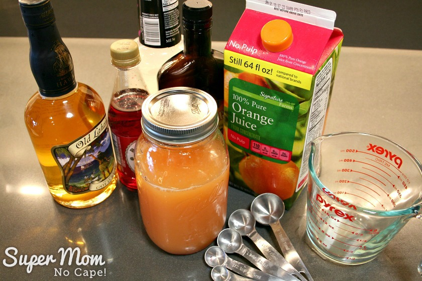Photo of the bottles of ingredient for Misty's Maui Mai Tais along with the mix that has been added to a mason jar