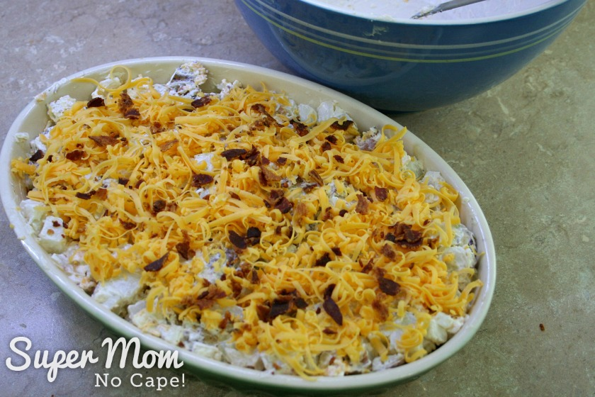 Grated cheddar cheese and crumbled bacon added to the top of the Leftover Baked Potato Casserole