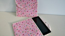 Photo of Two tablet cases . One with iPad inserted half way