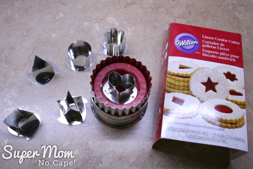 Linzer Cookie Cutter Kit showing interchangeable center cutting shapes laying on a kitchen counter