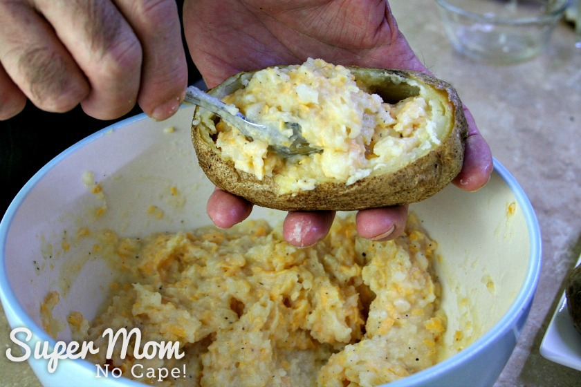 Scooping potato mixture into shells for Twice Baked Potatoes
