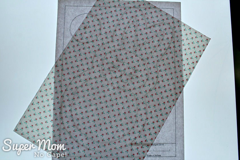 Tracing the rag quilt bunny pattern on one piece of fabric using a light box