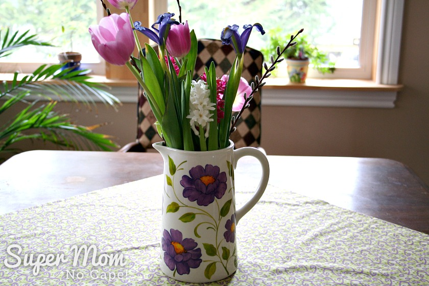 White Floral Vase filled with a bouquet of spring flowers