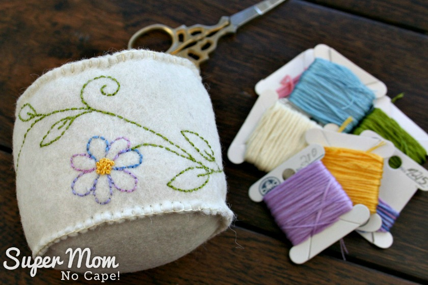 Side view of Butterfly Pincushion, embroidery floss and scissors