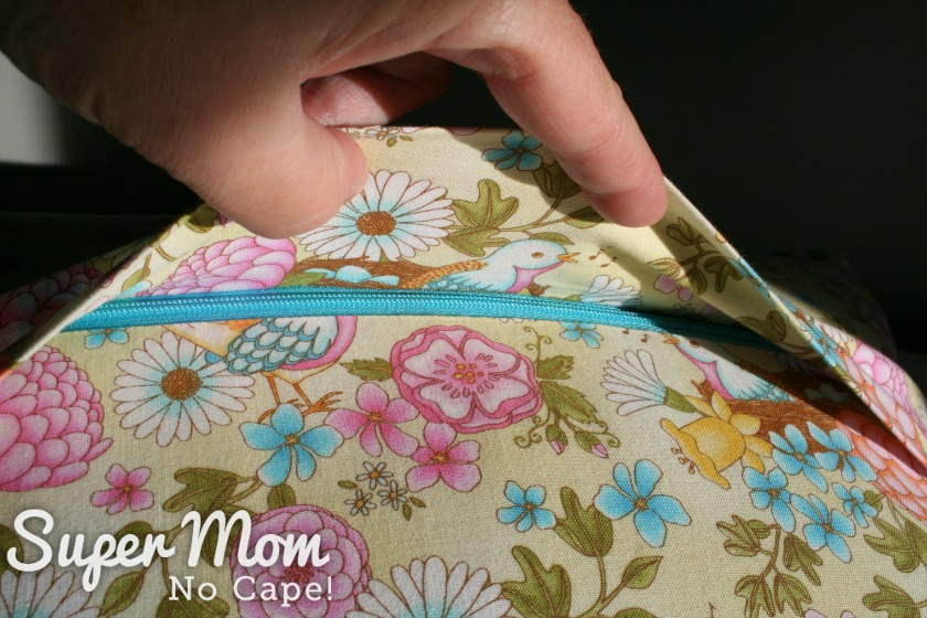 Zipper is concealed under a flap