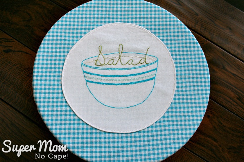 Salad Embroidery Pattern stitched on white fabric applied to gingham fabric
