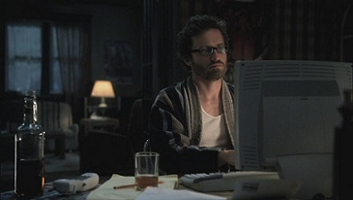 Supernatural's Chuck Shurley at the computer in a bathrobe.
