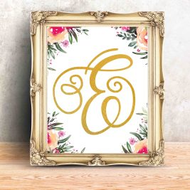 Golden Vintage photo frame at Concrete wall and wooden table,Tem
