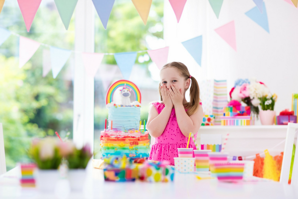 girly birthday party with toddler girl in pink dress