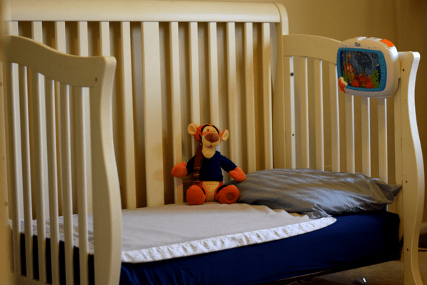 text on image-nervous about transitioning your toddler from crib to bed-image of bed
