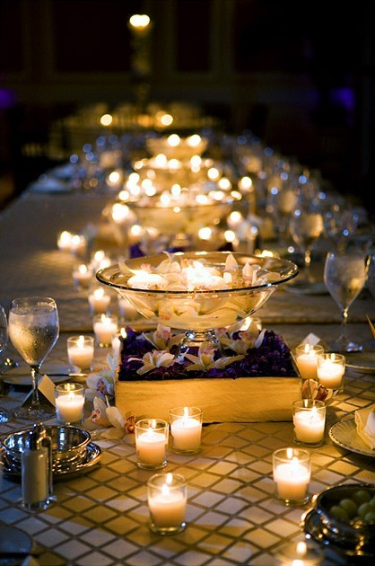 Wedding Centerpiece Created With Votive and Floating Candles