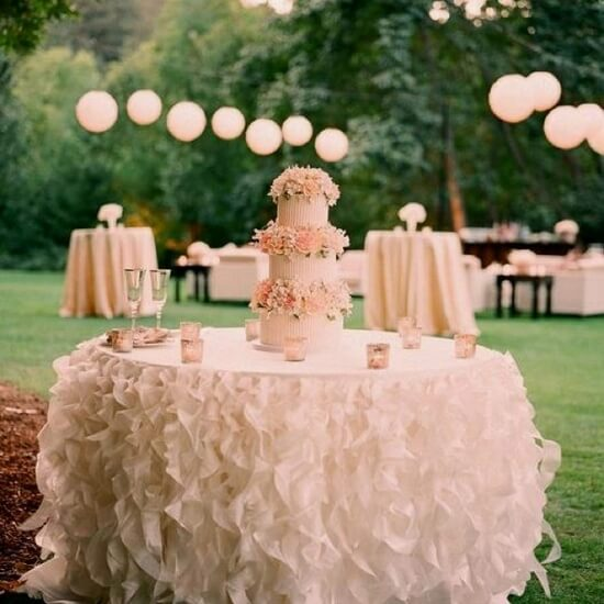 Wedding Cake Table with Ruffled Table Skirt