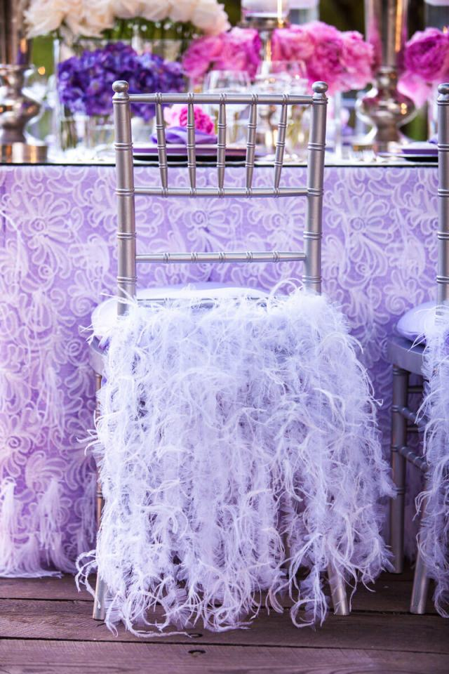 Lavender reception table decor with feathers on chairs