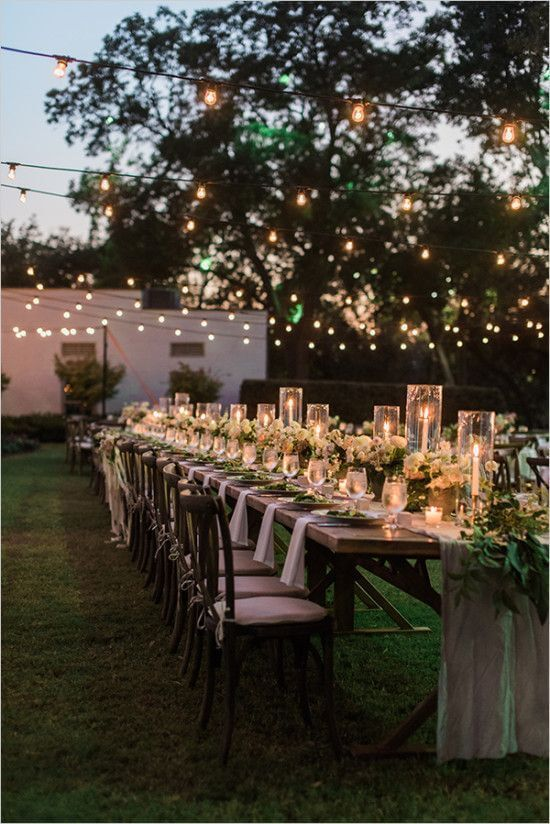 Backyard wedding reception with twinkle lights.