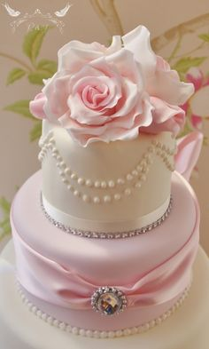 Small pink and white wedding cake.