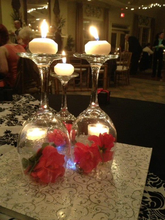 Upside down wine glass centerpieces for a Christmas wedding