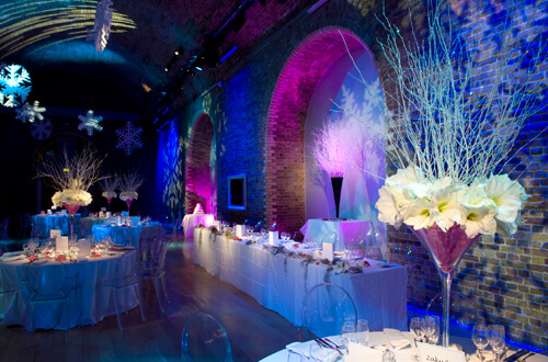 Snowflakes And Lighting Effects At Holiday Season Wedding With Purple Blue Color Scheme