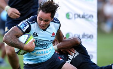 Zac Guildford is tackled in a Super Rugby warm up match