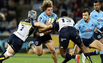Michael Hooper tries to break through his former team's defence