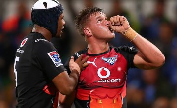 Hanro Liebenberg of the Bulls celebrates after crossing for a try