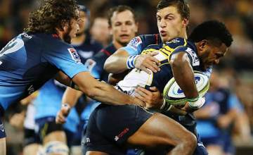Henry Speight defends the ball for the Brumbies against the Bulls