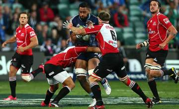 Patrick Tuipulotu tries to get through the Lions