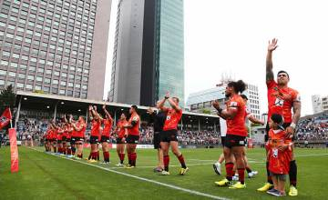 The Sunwolves wave to their fans