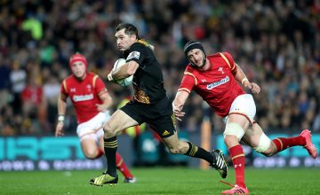 Stephen 'Beaver' Donald slips off a Wales tackle