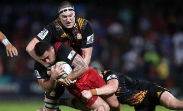 Brodie Retallick tackles Codie Taylor of the Crusaders