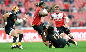 Howard Mnisi defends the ball for the Lions against the Jaguares