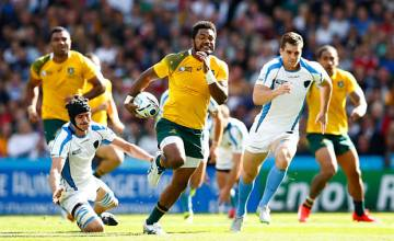 Wallaby winger Henry Speight races for the tryline against Uruguay