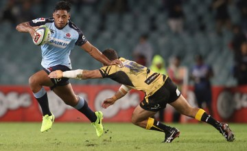 Jono Lance of the Force tackles Irae Simone of the Waratahs