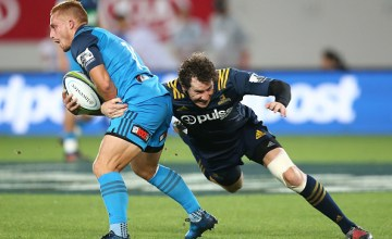 Ihaia West of the Blues is tackled by Marty Banks of the Highlanders in a Super Rugby match