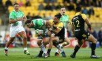Matt Proctor of the Hurricanes tackles Luke Whitelock of the Highlanders