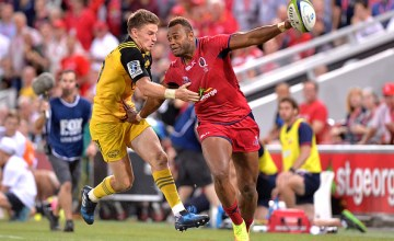 Reds player Eto Nabuli pushes away from the defence during the Super Rugby round six match between the Reds and the Hurricanes