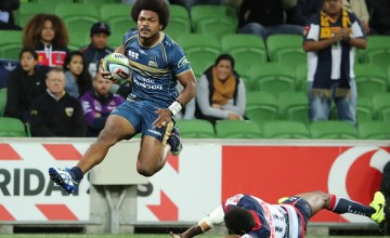 Henry Speight of the Brumbies runs in to score a try during a Super Rugby match