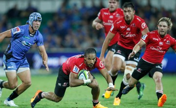 Courtnall Skosan of the Lions runs with the Super Rugby ball