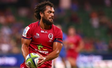 Karmichael Hunt of the Reds looks to pass the ball during the round two Super Rugby match between the Western Force and the Reds