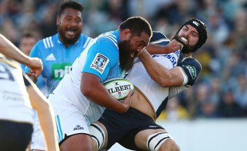 Charlie Faumuina of the Blues is tackled by Scott Fardy of the Brumbies during the round 10 Super Rugby match