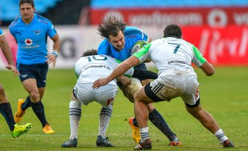 Marty Banks of the Highlanders and Dillon Hunt of the Highlanders tackling Burger Odendaal o