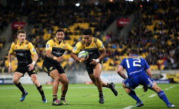 Julian Savea of the Hurricanes makes a break on his way to scoring a try during the round 11 Super Rugby match